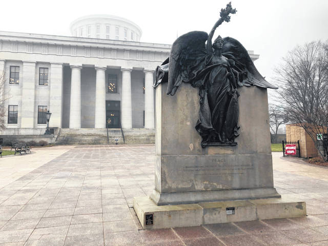 """""""Peace,"""" a statue on the grounds of the Ohio Statehouse that commemorates Civil War soldiers """"And The Loyal Women Of That Period,"""" stands clear of morning fog on Wednesday, Jan. 15, 2020, in Columbus, Ohio. The Statehouse grounds don't include a statue of a real woman from Ohio history, an occurrence the Women's Suffrage Centennial Commission hopes to remedy by proposing a new memorial honoring the women who fought for the right to vote."""