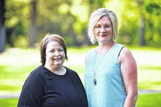 This July 31, 2019 photo shows Stillwater Christian School parents Jeri Anderson and Kendra Espinoza at Woodland Park in Kalispell, Mont. The Supreme Court will hear arguments Wednesday, Jan. 22, 2020 in a dispute over a Montana scholarship program for private K-12 education that also makes donors eligible for up to $150 in state tax credits. Advocates on both sides say the outcome could be momentous because it could lead to efforts in other states to funnel taxpayer money to religious schools.