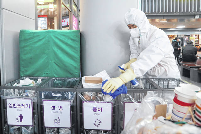 FILE - In this Jan. 24, 2020, file photo an employee works to prevent a new coronavirus at Suseo Station in Seoul, South Korea. On Friday, Jan. 24, 2020, The Associated Press reported on the false claim that the coronavirus outbreak spreading from China is nothing new and that patents were created around it years ago. The patents being shared online are not related to the new respiratory virus that has sickened hundreds of people in China and caused concern around the world. (AP Photo/Ahn Young-joon, File)