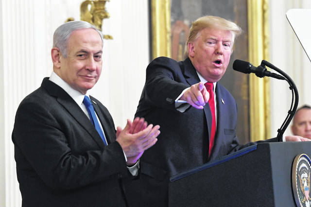 President Donald Trump speaks during an event with Israeli Prime Minister Benjamin Netanyahu in the East Room of the White House in Washington, Tuesday, Jan. 28, 2020.