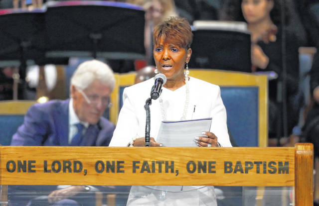 "FILE - In this Aug. 31, 2018, file photo, Sabrina Owens reads the obituary during the funeral service for Aretha Franklin at Greater Grace Temple in Detroit. Owens, Franklin's niece, said she's quitting as representative of the late singer's estate, citing a rift in the family since handwritten wills were discovered last year. ""Given my aunt's love of family and desire for privacy, this is not what she would have wanted for us, nor is it what I want,"" Sabrina Owens said in a letter filed Thursday, Jan. 30, 2020, in a suburban Detroit court."