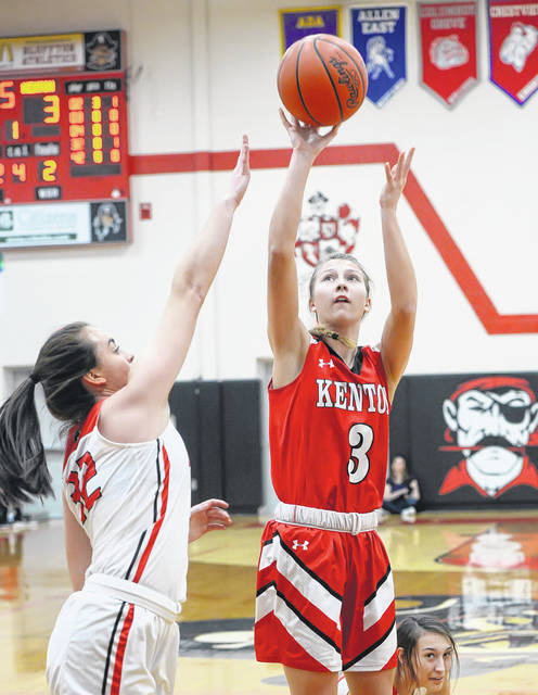 Kenton's Hannah Holland puts up a shot against Bluffton's Libby Schaadt during Thursday night's game at Bluffton.