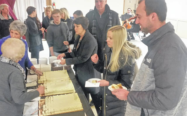 Dozens of people turned out Sunday to taste cakes from Baked to Perfection in Delphos.