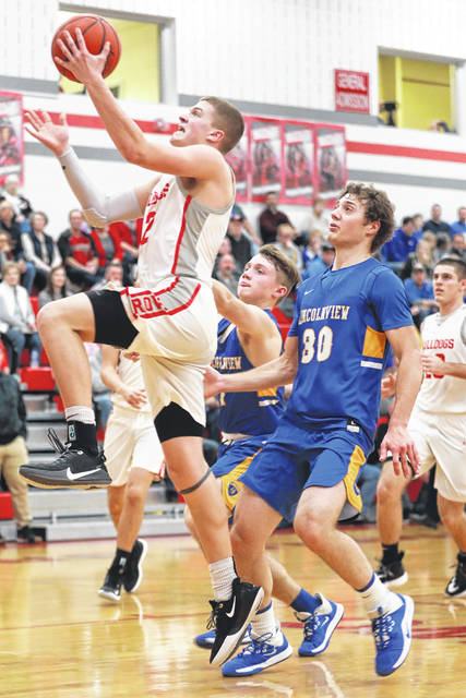 Columbus Grove's Blake Reynolds puts up a shot during Friday night's home game against Lincolnview.