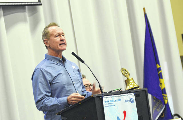 Cooper Farms Chief Operating Officer Gary Cooper shares some insights into his family business during a speech at the Rotary Club of Lima on Monday.