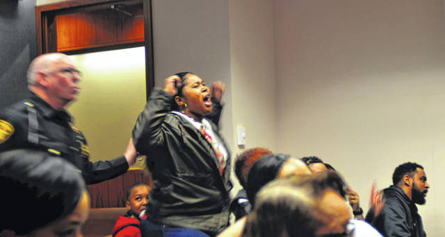 Portions of the crowd erupted in celebration upon hearing Kenneth Cobb's murder acquittal at 7:30 p.m. Friday night.