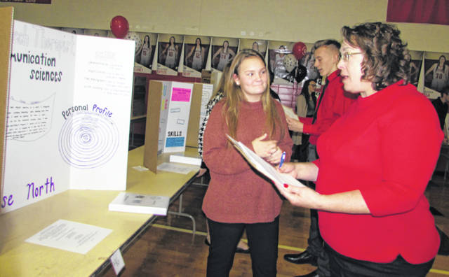 Elyse North, Delphos Jefferson High School freshman, discusses her career plans with Beth Seibert, Allen Soil and Water Conservation District coordinator Friday at the high school.