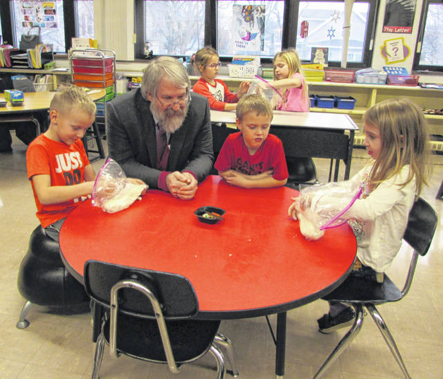 From left are Franklin Elementary kindergartener Kellen Grothaus, Paola DeMaria, Ohio state superintendent of public instruction, and kindergarteners Jason Meihls, Amelia Shipley and Amanda Wrasman.