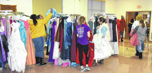 Dozens of girls came out to the Diva's Den dress giveaway Saturday to pick out a free prom dress.