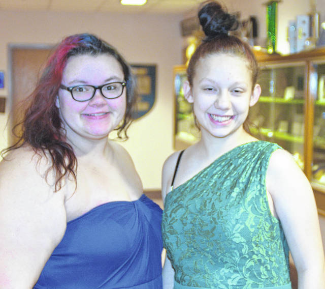 Alexis Thompson and Jenna Ridenour show off their prom dresses they got from the Diva's Den dress giveaway Saturday.