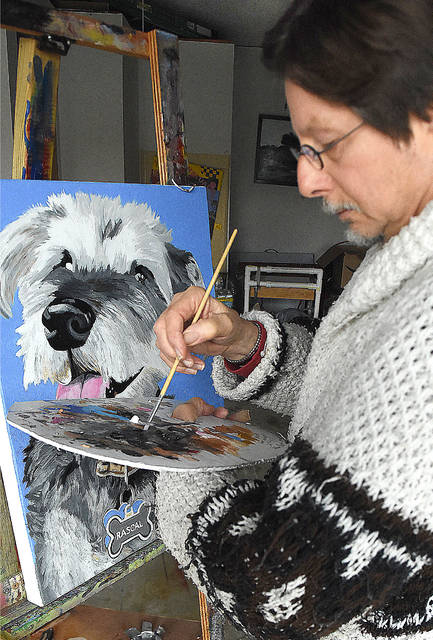"Local artist, Herb Vondreau works on a dog portrait painting called, ""Rascal"" while working at his studio in Shawnee Township. Craig J. Orosz 