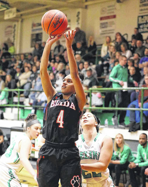 Elida's Amira Freeman puts up a shot during Thursday night's game in Celina.