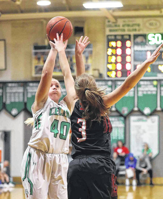 Celina's Emma Homan puts up a shot against Elida's Rachel Mitchell during Thursday night's game in Celina.