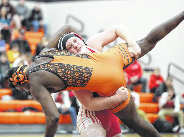 Wapakoneta's Evan Kaeck picks up Elida's Tarez Russell during Thursday night's wrestling meet at Elida.