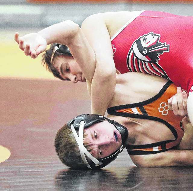 Wapakoneta's Bryce Knapke, top, competes against Elida's Zach Nelms during Thursday night's wrestling meet at Elida.