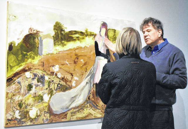 """Artist Eric Finzi was at his """"Do you hear the children weeping?"""" exhibit opening on Thursday to discuss the work with exhibit goers."""