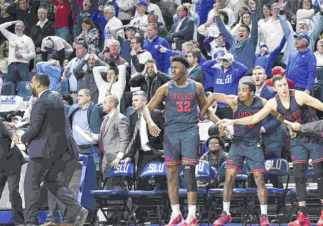Dayton's bench reacts after the winning three-point shot by Dayton Flyers guard Jalen Crutcher (10) in overtime during an Atlantic 10 Conference basketball game between Dayton and St. Louis last Friday night.