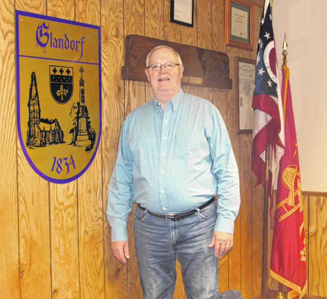 Gene Warnecke, who retired after 26 years as Glandorf's mayor, is pictured in the village hall.