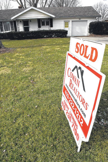 A sold sign marks a home on Copus Road in Shawnee Township.