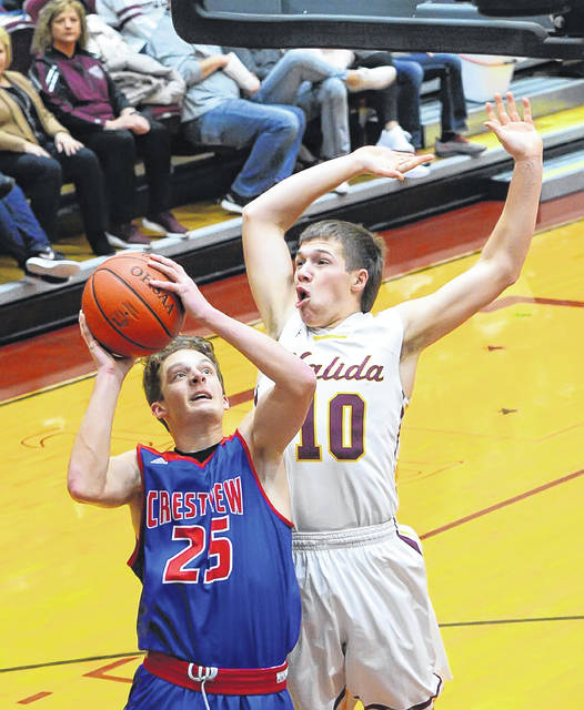 Crestview's Nathan Lichtle puts up a shot against Kalida's Gabe Hovest during Friday night's game at Kalida.