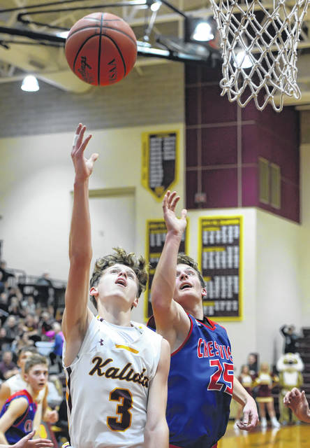 Kalida's Brandon Miller puts up a shot against Crestview's Nathan Lichtle during Friday night's game at Kalida.