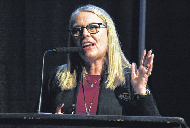 Keynote speaker Karen Grothouse, CEO of Spherion of Lima, addresses the Lima/Allen County Chamber of Commerce's annual breakfast on Friday morning at the Civic Center in downtown Lima.