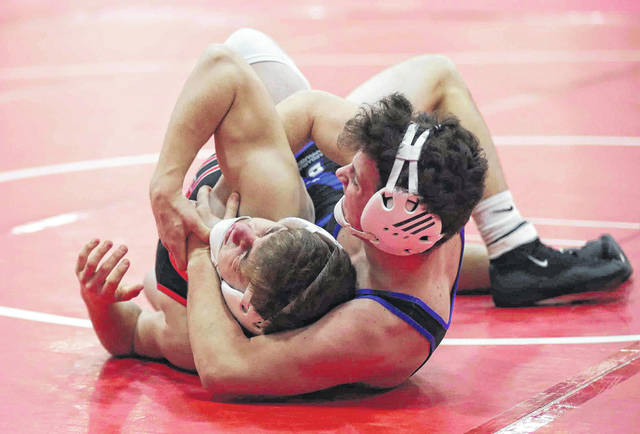 Allen East's Drake Carmean, right, competes against Ashland Crestview's Brent Eicher during Saturday's LCC Thunderbird Invitational at Lima Central Catholic.
