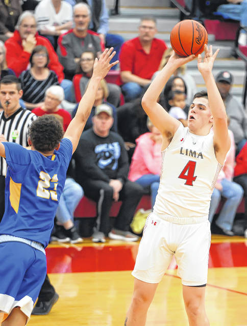 Lima Senior's Dante Wheeler puts up a shot against Findlay's A.J. Adams during Friday night's game at Lima Senior.