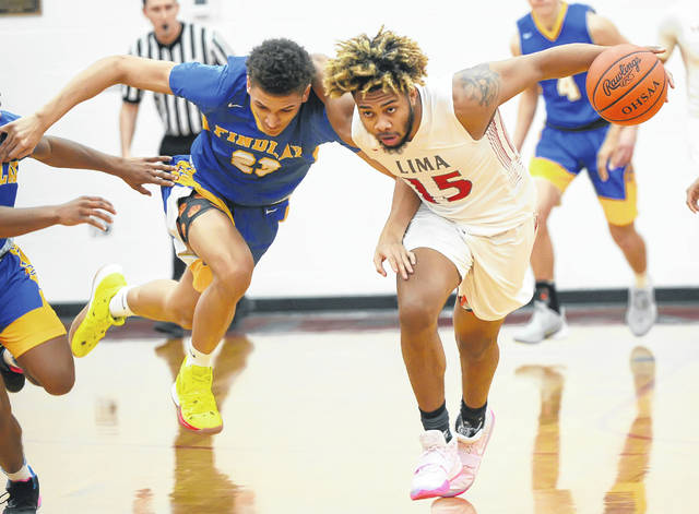Lima Senior's Jamir Simpson dribbles up court against Findlay's A.J. Adams during Friday night's game at Lima Senior.