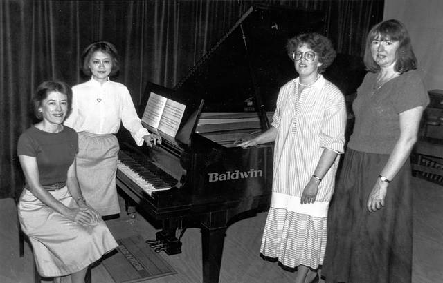 The Etude club piano quartet was photographed in May 1987 at Miller-Patterson Music Store. From left: Barbara Young, Li-Chuan Li, Ann Munsterman and Mary Unverferth.
