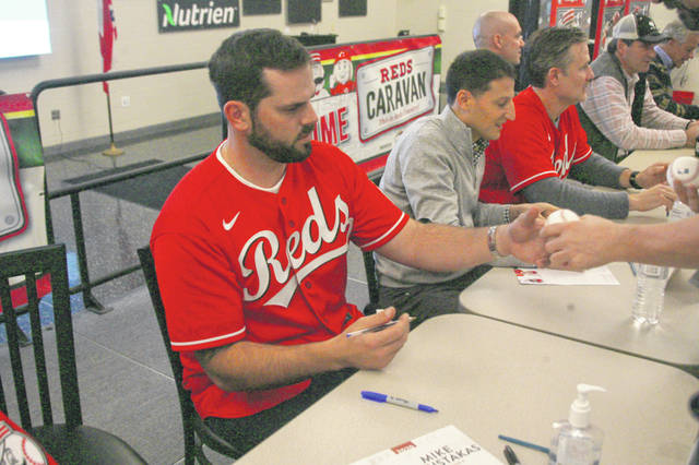 Mike Moustakas, who the Reds signed as a free agent this off season, signs autographs for fans at the Reds annual caravan stop in Lima.