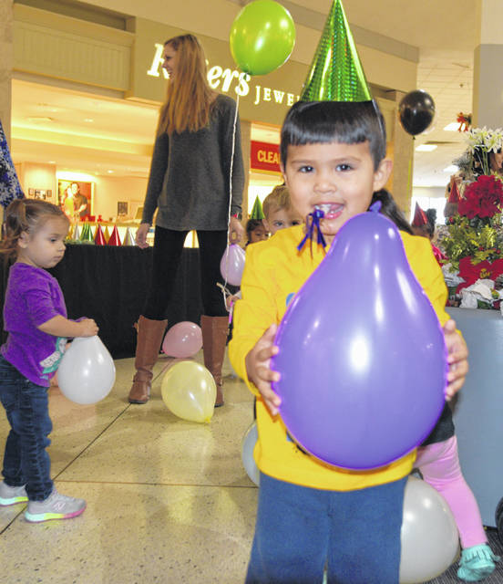 A.J. Talkalai, 2, celebrates the new year with an event Saturday at the Lima Mall.