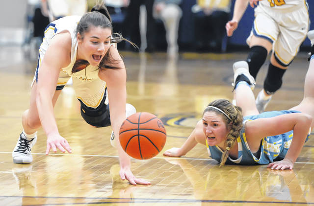 Ottawa-Glandorf's Chloee Glenn, left, and Bath's Madelyn Renner attempting to retireve a loose ball during Thursday night's game in Ottawa.