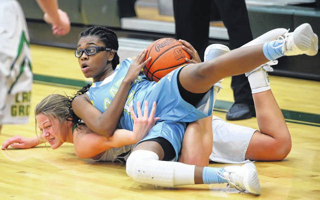 Bath's Ja'Dasia Hardison grabs a loose ball against Ottoville's Nicole Knippen during Tuesday night's game in Ottoville.