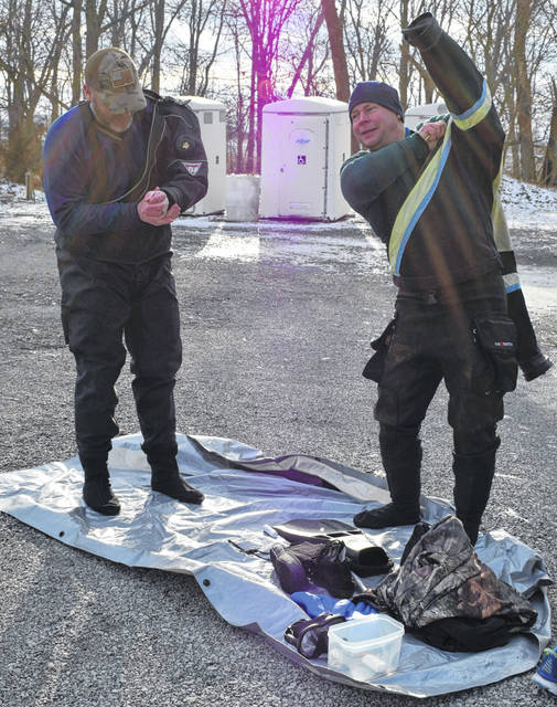 Jeremy Nussbaum, right, of Polk, and his friend Brian Gault, of Nova, put on their drysuits, which can be pumped with a layer of air for insulation.