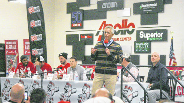 Reds broadcaster Thom Brennaman addresses those attending the annual Reds caravan stop Friday at the Apollo Career Center in Lima. Brennaman said this is one of the largest and best stops in Ohio.