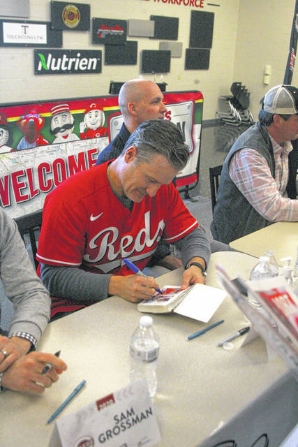 Reds manager David Bell signs autographs for fans Friday during the annual Reds Caravan stop in Lima at Apollo Career Center.