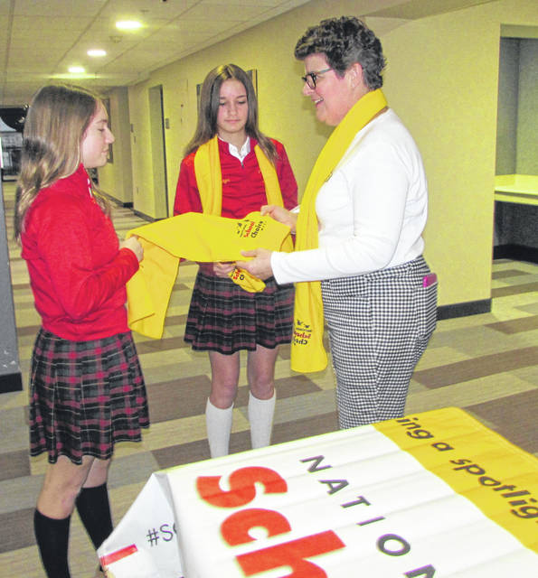 Emma Donley and Carsyn Dafler, eighth-grade at St. Charles Catholic School who were helping at the school's table, talk with Ann Riddle, Northwest Ohio Scholarship Fund executive director, during School Choice School Fair Thursday at Mercy Health-St. Rita's Medical Center Auxiliary Conference Center.
