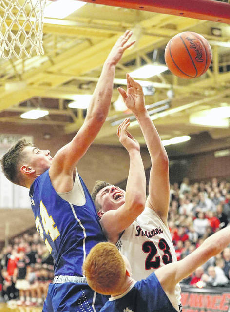 St. Marys' Ethan Steger defends a shot by Shawnee's George Mangas during Friday night's game at Shawnee.