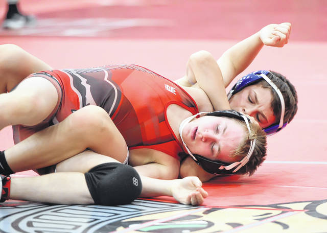 Spencerville's Carder Miller, top, wrestles Antwerp's Eli Reinhart during Saturday's Spartan Invitational at Lima Senior.
