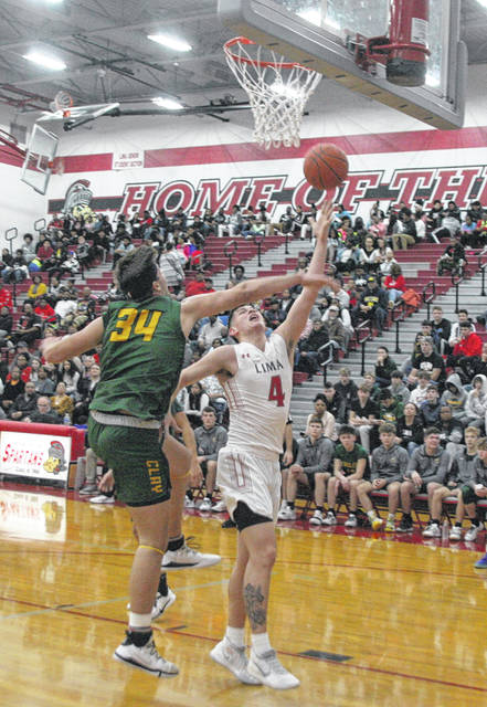 Lima Senior's Dante Wheeler looks to get past Oregon Clay's Dylon Fisher during Friday night's game at Lima Senior.