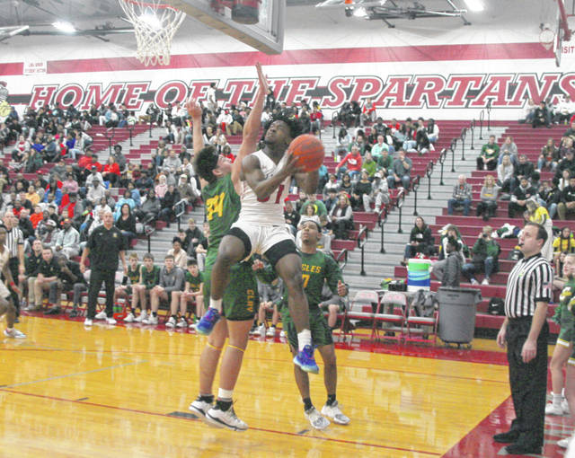 Lima Senior's Camren Miles goes for a shot against Oregon Clay's Dylon Fisher during Friday night's game at Lima Senior.