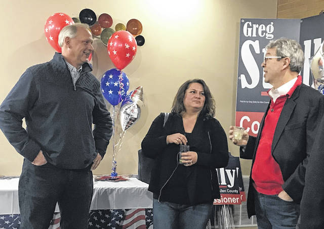 Greg Stolly, left, talks with friends and supporters during his campaign kickoff party at Westgate Lanes on Thursday.