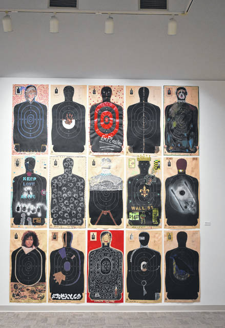 """Each piece in the """"Human Targets"""" by Margaret Brostrom and George Cooley each has its own message created onto the NRA human silhouette targets."""