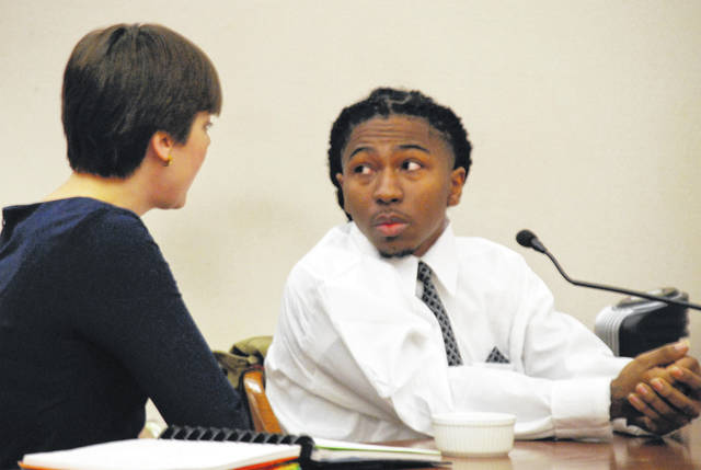 Rasheign Tisdale confers with his attorney, Andrea Henning, prior to his sentencing hearing Thursday in Allen County Common Pleas Court.