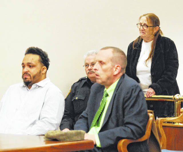 The mother of Shay Williams, standing, addresses Judge Jeffrey Reed on Thursday during a sentencing hearing for her son. Williams was sentenced to 24 years in prison for trafficking in cocaine in Lima.