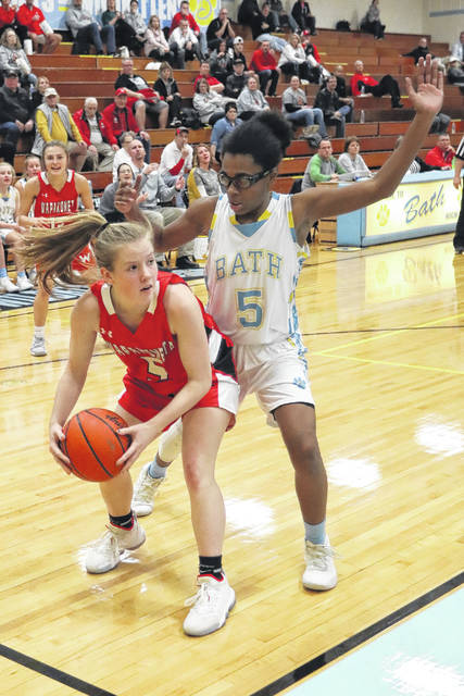 Bath's Ja'Dasia Hardison guards Wapakoneta's Nikane Ambos during Thursday night's game at Bath.