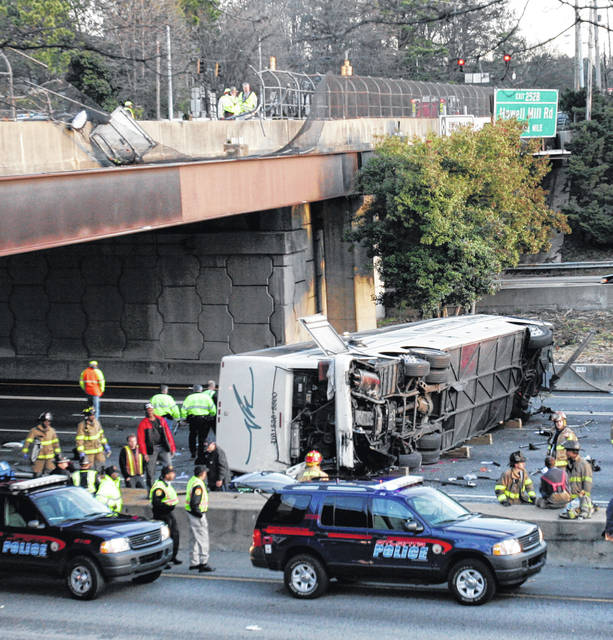 This March 2, 2007, photo shows a charter bus carrying the Bluffton University baseball team from Ohio after it plunged off a highway ramp in Atlanta and slammed into the I-75 pavement below. (AP Photo/Gene Blythe, File)