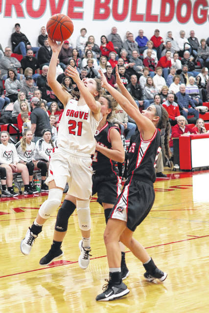 Columbus Grove's Kenzie King puts up a shot during Thursday night's home game against Spencerville.
