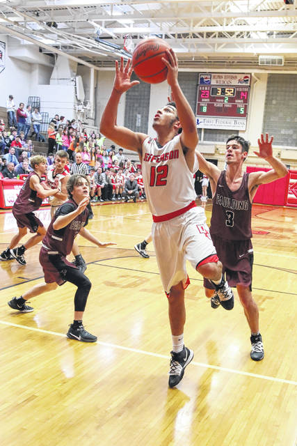 Delphos Jefferson's Logan Herron puts up a shot during Friday night's game against Paulding in Delphos.